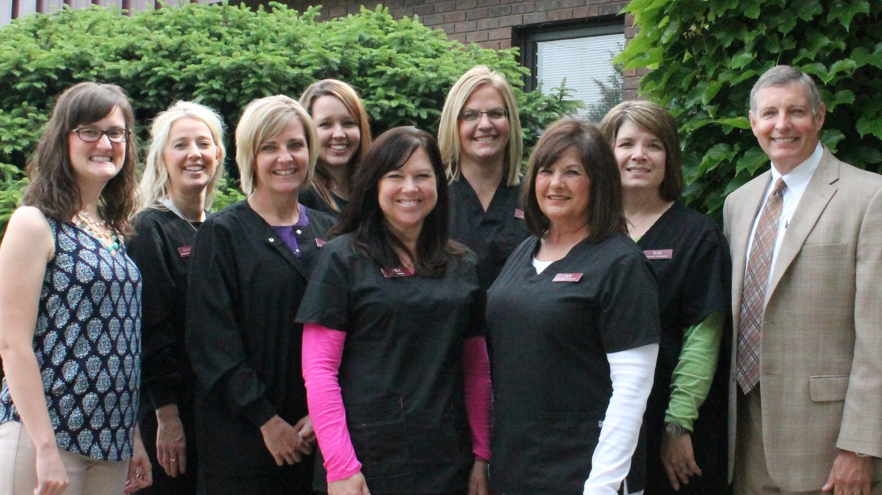From left to right:Dr. Bethany J. Olson, Shannon Ostransky (dental hygienist), Sara Kellogg (dental hygienist), Earlene Bedsole (dental assistant), Carla Walters (dental assistant), Tiffany Siffring (dental assistant), Deb Siffring (scheduling), Jean Miller (financial), Dr. Nicholas R. Saeger